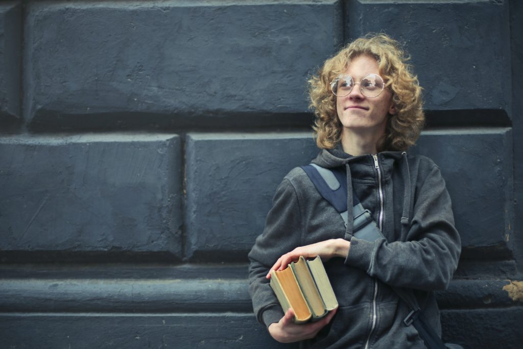 Boy Standing with Book